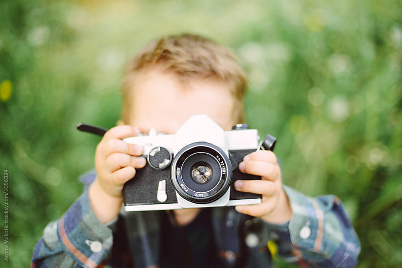 Child with an analog camera by Jovana Vukotic for Stocksy United