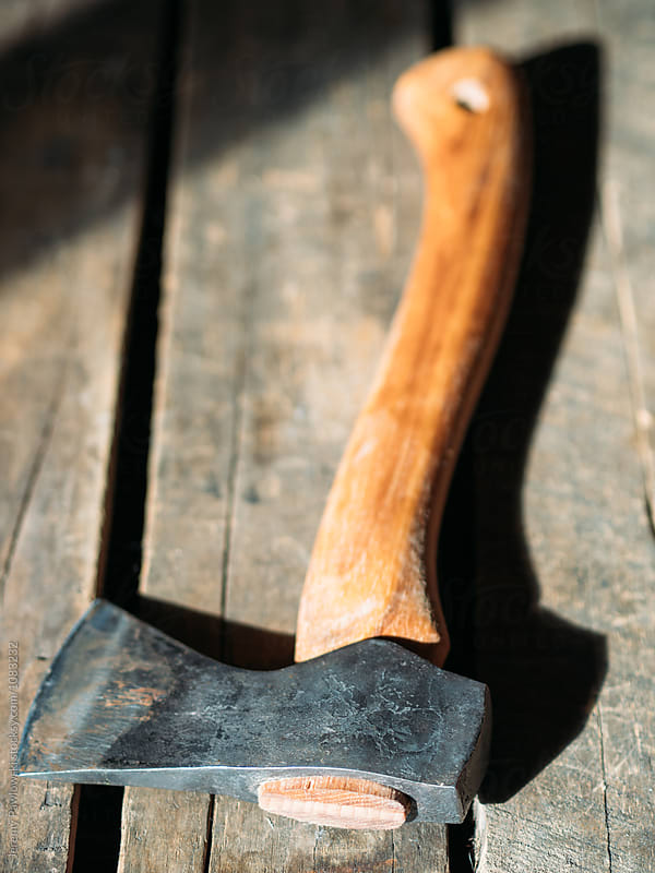 Hand crafted metal and wood hatchet  by Jeremy Pawlowski for Stocksy United