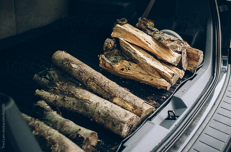 Heap of firewood in car boot trunk by Trent Lanz for Stocksy United