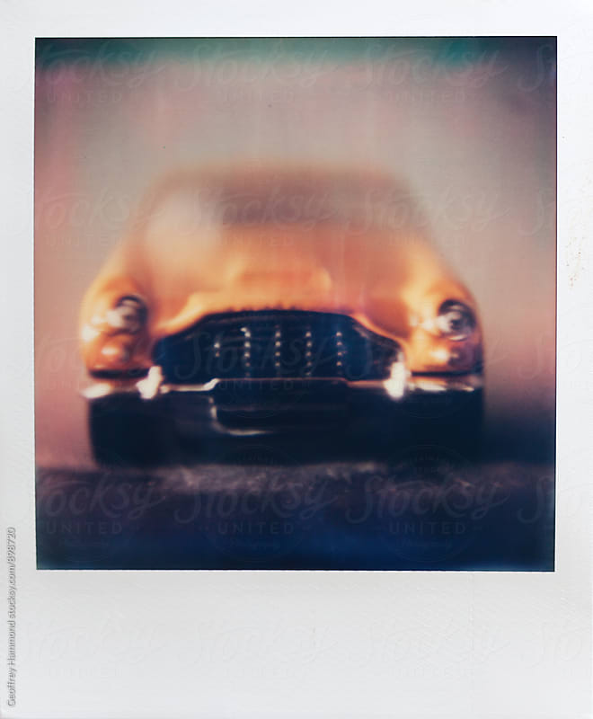 Polaroid Macro Photo of Toy Car, Front by Geoffrey Hammond for Stocksy United