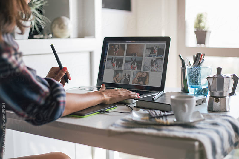 Designer - woman working from home on her laptop by Jovo Jovanovic for Stocksy United