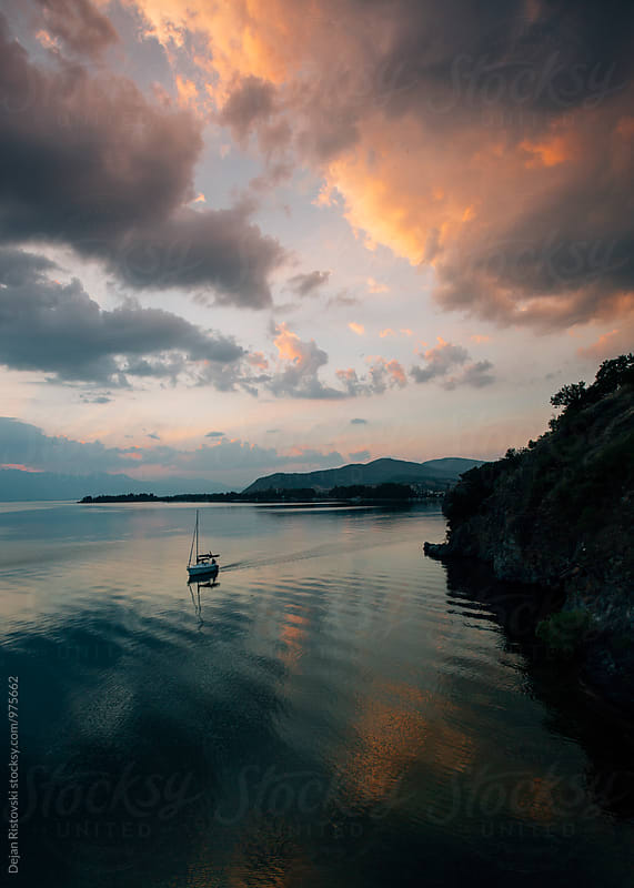 Idyllic view on Ohrid lake at sunset by Dejan Ristovski for Stocksy United