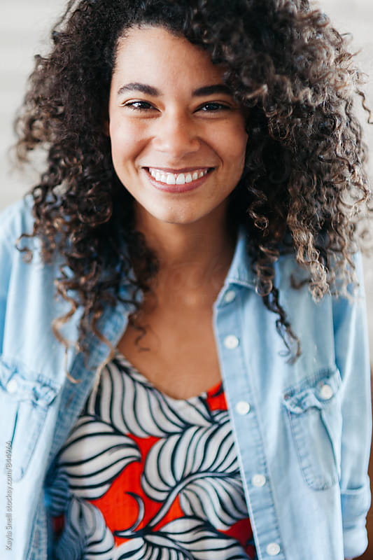 Beautiful woman with curly hair by Kayla Snell for Stocksy United
