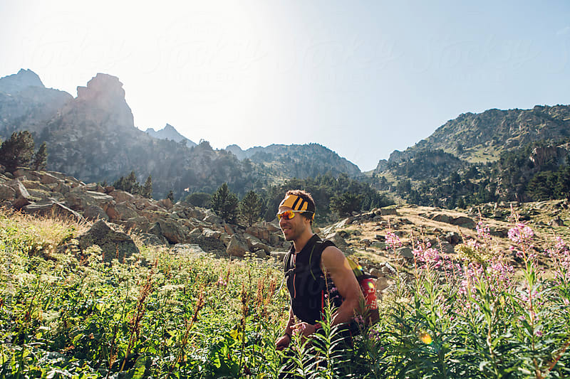 Young sporty male hiking in the National Park by Jordi Rulló for Stocksy United