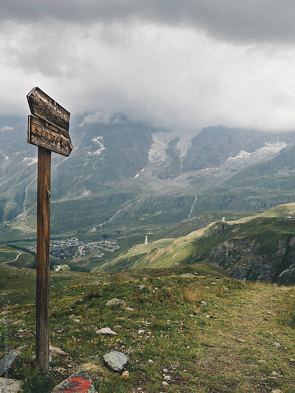 Wooden sign on the mountains by Milena Milani for Stocksy United