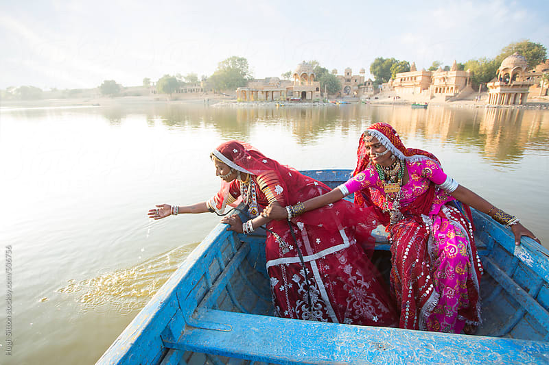Rajasthani women at the lake in the desert. Rajasthan. India by Hugh Sitton for Stocksy United