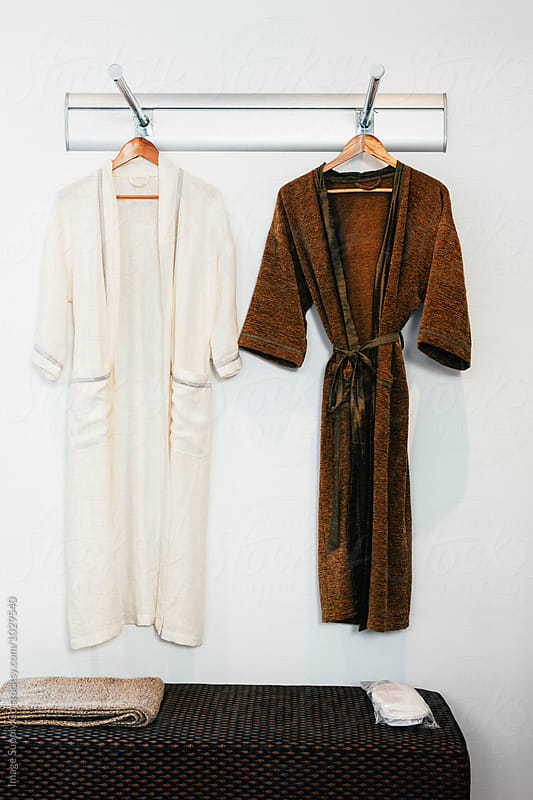 Two luxurious robes hanging on wall by Image Supply Co for Stocksy United