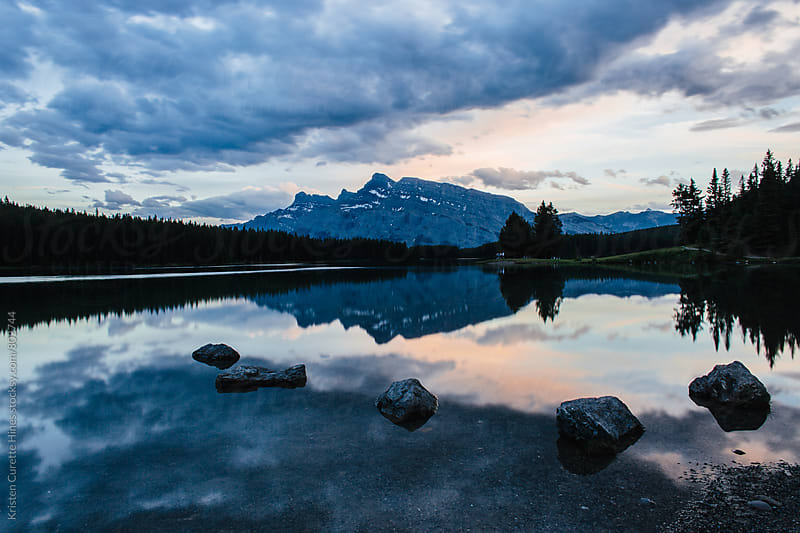 Sunset at Two Jack Lake  by Kristen Curette Hines for Stocksy United