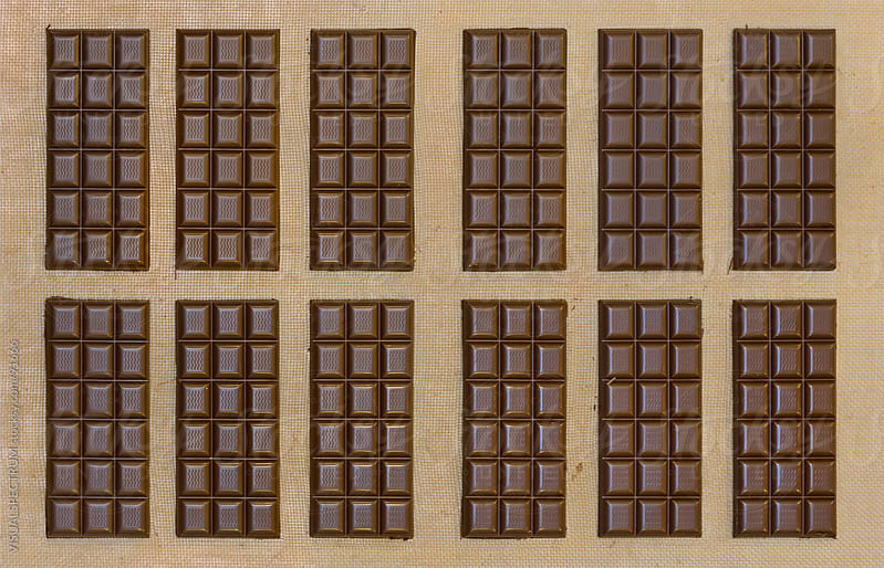 Twelve Chocolate Bars by VISUALSPECTRUM for Stocksy United