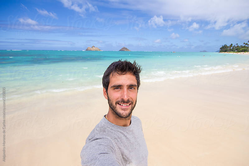 young man selfie on exotic tropical beach by alejandro