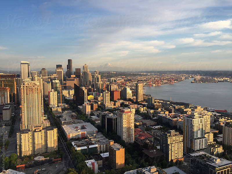 Seattle city skyline with Mt Ranier behind by Mick Follari for Stocksy United