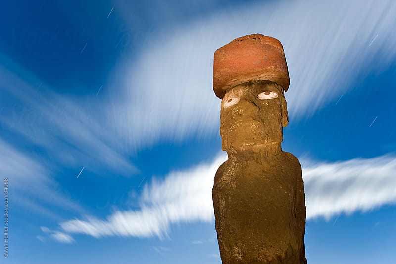 South America, Chile, Rapa Nui, Isla de Pascua (Easter Island), Moai statue Ahu Ko Te riku, the only topknotted and eyeballed Moai on the Island - backlit by moonlight by Gavin Hellier for Stocksy United
