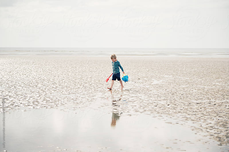Little boy walking on the beach by sally anscombe for Stocksy United