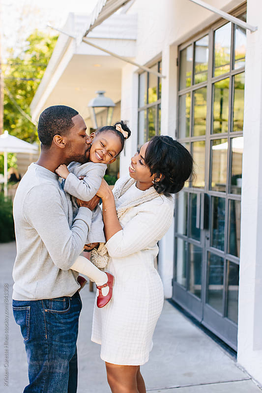 Candid joy of a family's love for one another.  by Kristen Curette Hines for Stocksy United