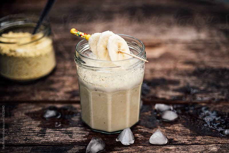Food: Vegan Protein Drink with Soy milk, lupins flour, banana, vanilla and ice cubes by Ina Peters for Stocksy United