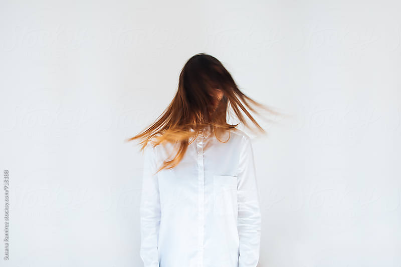 Woman moving her hair by Susana Ramírez for Stocksy United