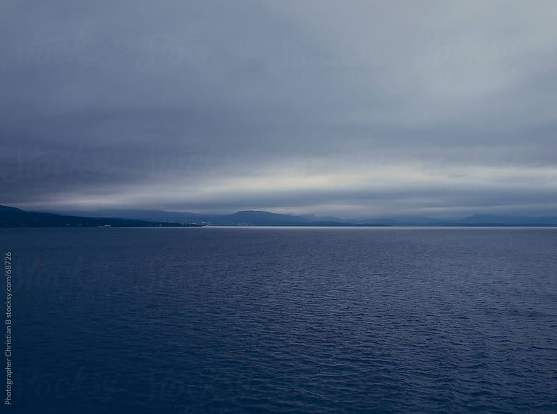 Coastline on a rainyday by Photographer Christian B for Stocksy United