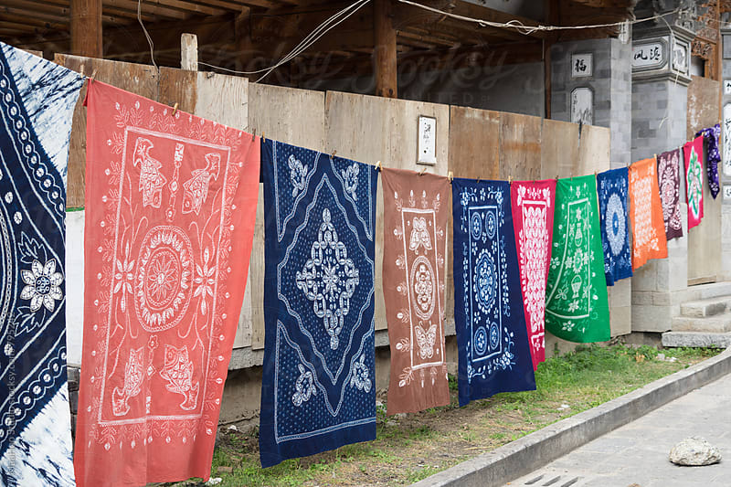 Colorful batik hanging outdoors by Maa Hoo for Stocksy United