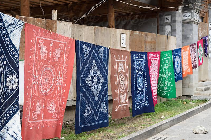 Colorful batik hanging outdoors by MaaHoo Studio for Stocksy United