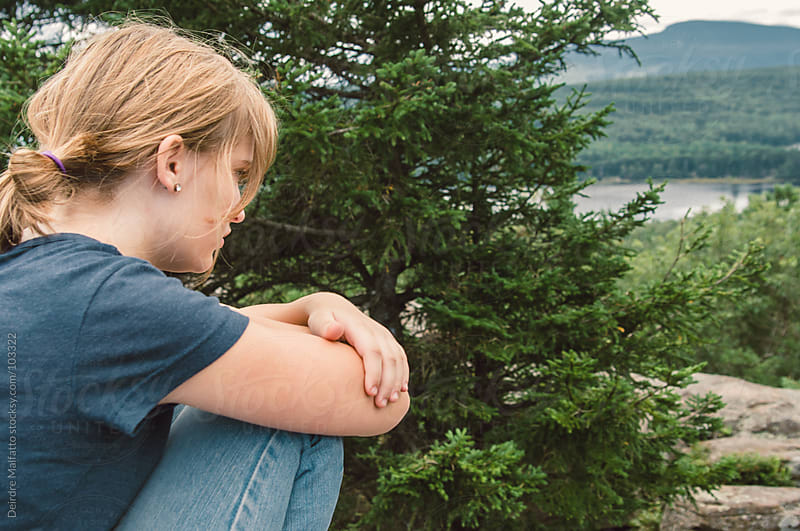 girl looking at view from mountain after hike by Deirdre Malfatto for Stocksy United