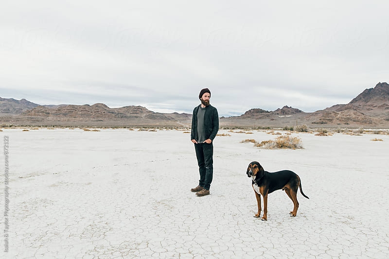 Man and dog best friend by Isaiah & Taylor Photography for Stocksy United