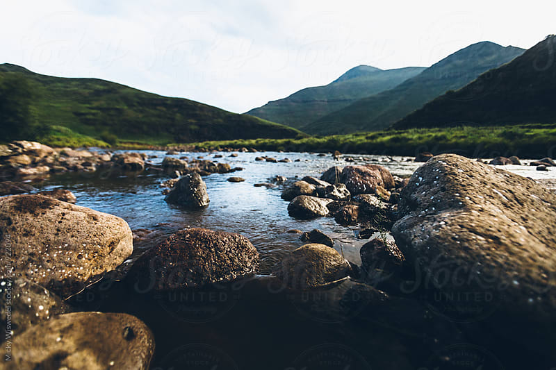 River and rocks landscape by Micky Wiswedel for Stocksy United