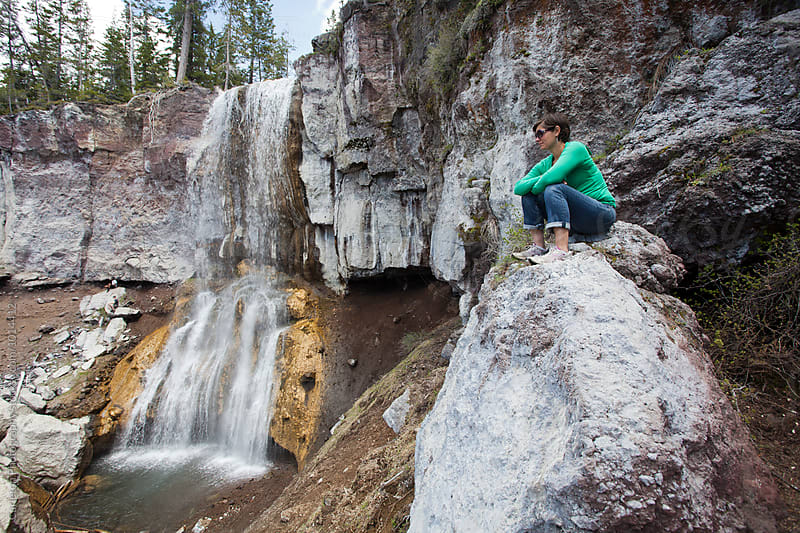 Woman enjoys a spectacular waterfall by Carleton Photography for Stocksy United