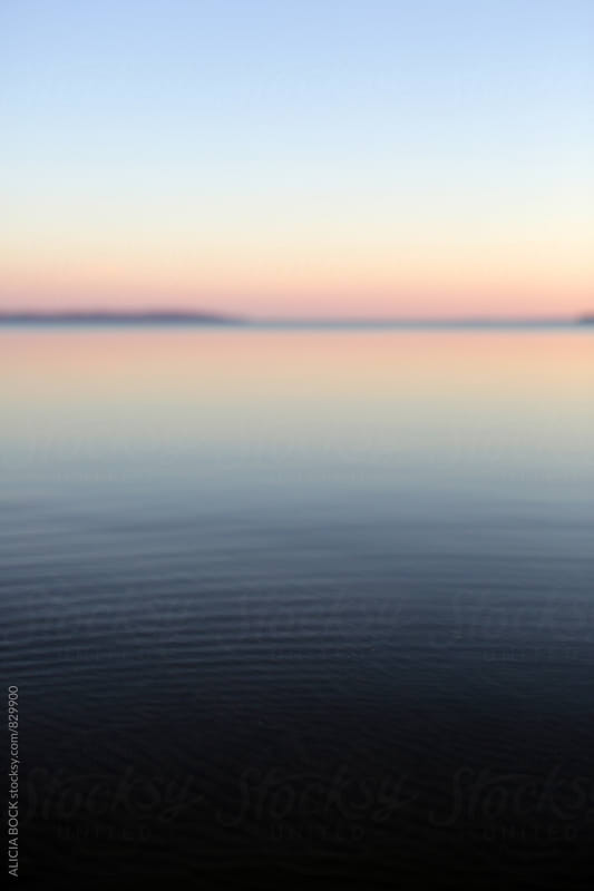 Sunrise Over A Calm Blue Lake On A Clear Morning by ALICIA BOCK for Stocksy United