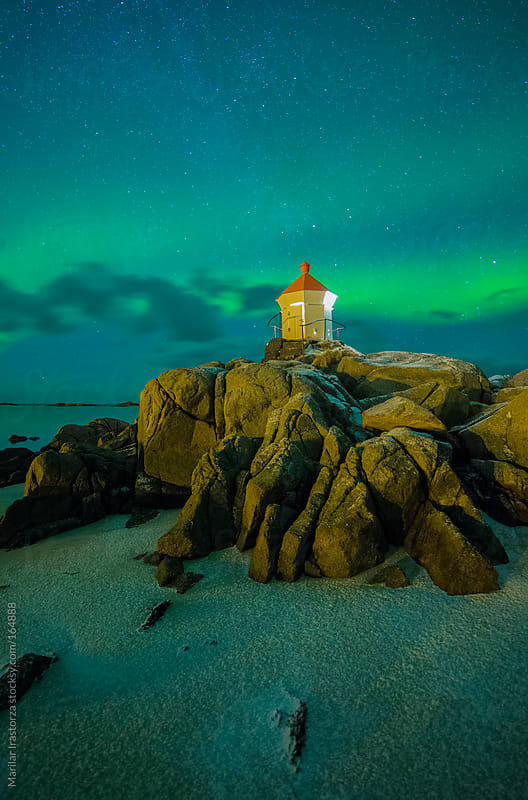 Aurora borealis over lighthouse Eggum by Marilar Irastorza for Stocksy United