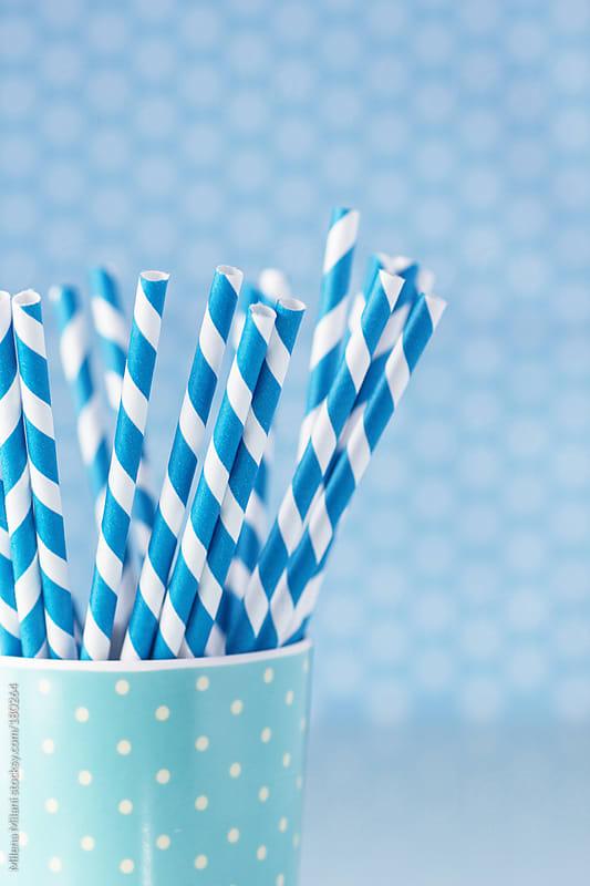Blue paper straws  by Milena Milani for Stocksy United