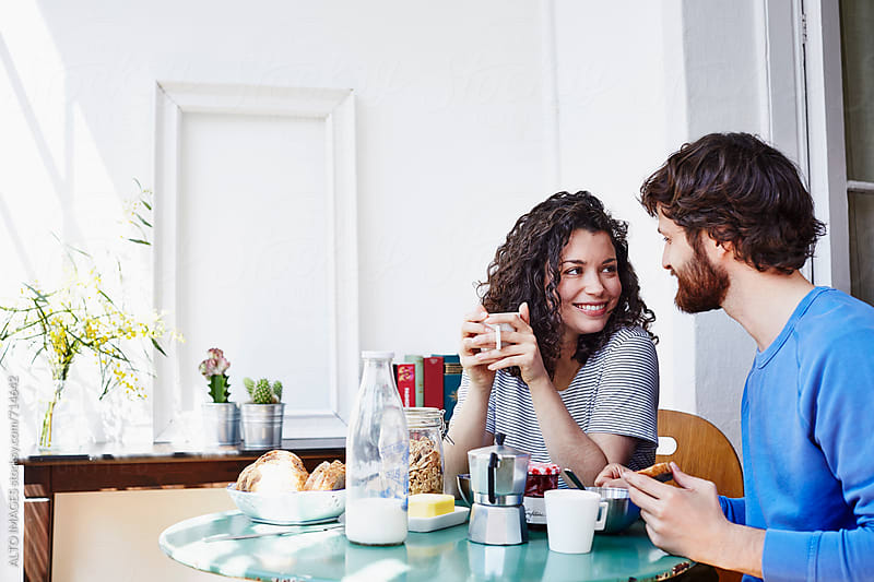 Loving Couple Having Breakfast At Home by ALTO IMAGES for Stocksy United