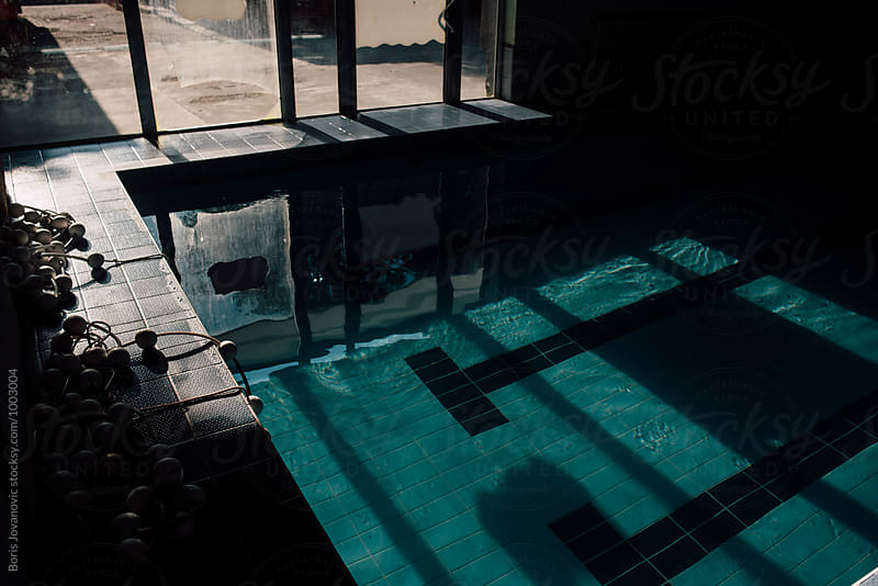 Swimming pool inside of the building by Boris Jovanovic for Stocksy United