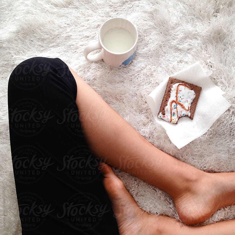Girl in Yoga Pants Sitting with Breakfast by B. Harvey for Stocksy United