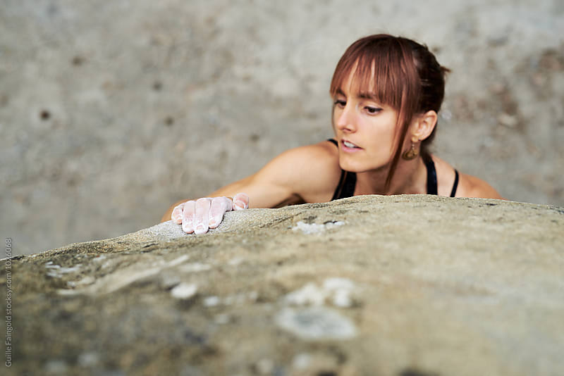 Close-up of brunette climbing with hands by Guille Faingold for Stocksy United