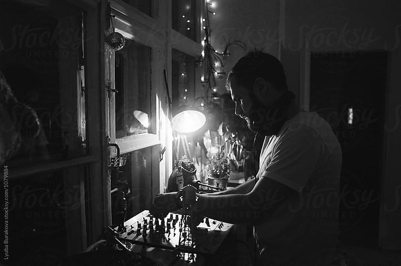 Silhouette of a man playing vinyl at home by Lyuba Burakova for Stocksy United