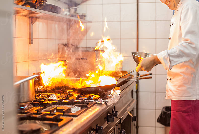 Chef Preparing Food in a Restaurant Kitchen by Mosuno for Stocksy United