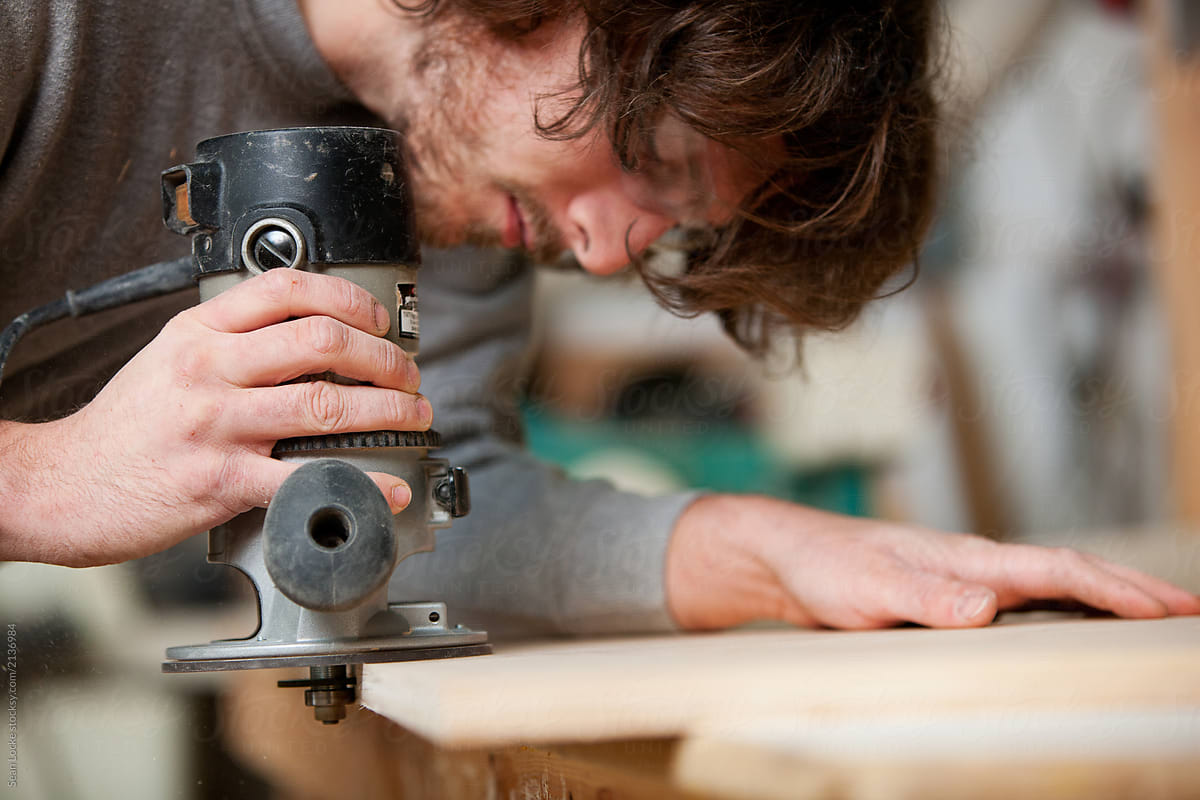 Woodworking: Man Routing Out Holes For Biscuits by Sean Locke - Cabinet,  Carpentry