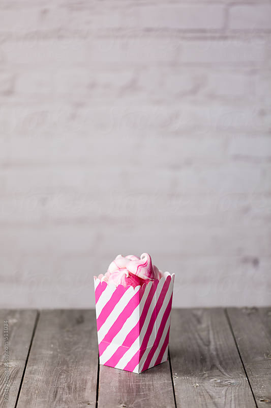 Prink striped Meringue Kisses in pink and white treat box by Kirsty Begg for Stocksy United