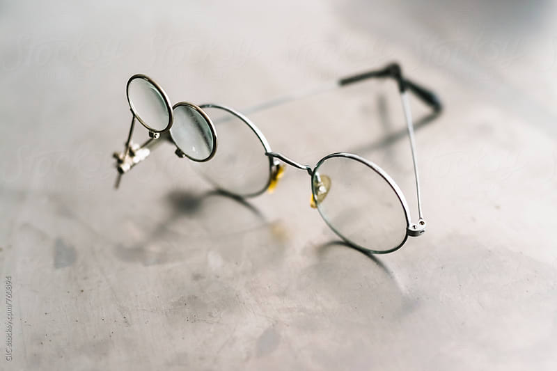 Glasses with magnifying glass by GIC for Stocksy United