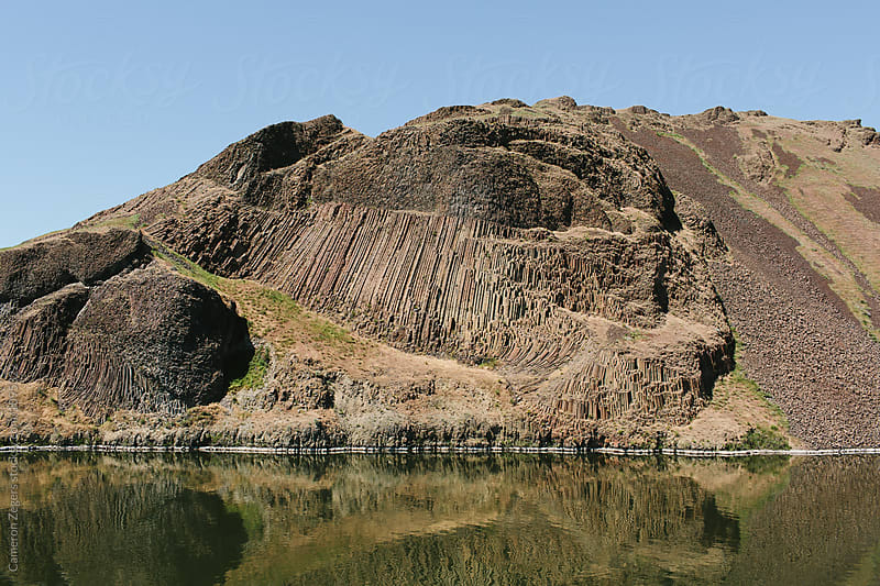 columnar basalt geology along Columbia River by Cameron Zegers for Stocksy United