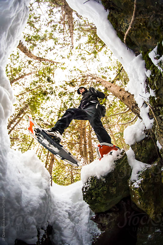 Active Outdoor Winter Lifestyle Man Snowshoeing In Winter Snow by JP Danko for Stocksy United