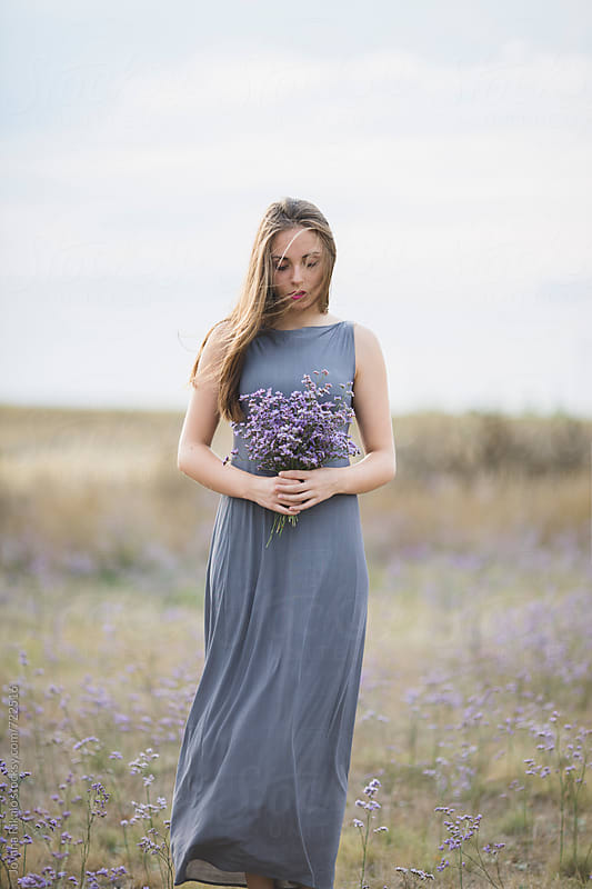 Beautiful young woman holding flower bouquet by Jovana Rikalo for Stocksy United
