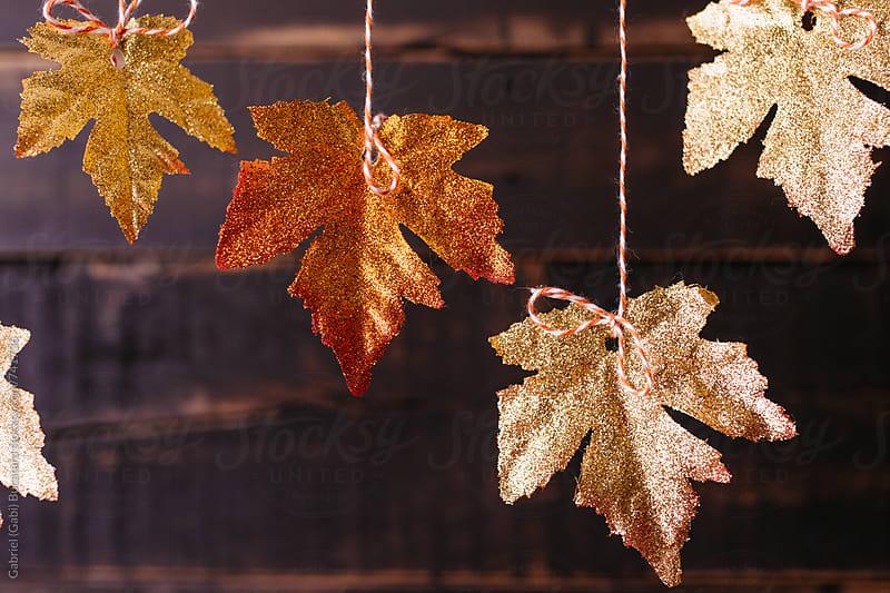 Glitter covered fall maple leaves by Gabriel (Gabi) Bucataru for Stocksy United