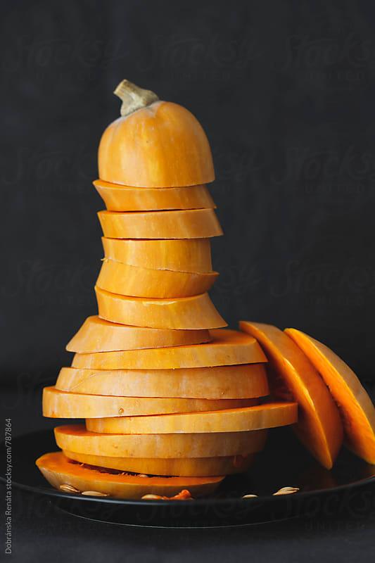 Stack of pumpkin slices by Dobránska Renáta for Stocksy United
