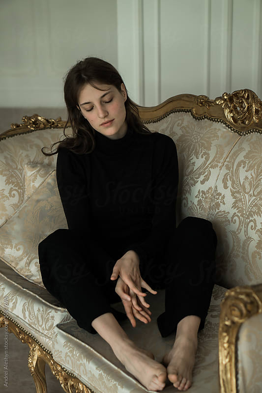 beautiful young girl on a vintage couch by Andrei Aleshyn for Stocksy United