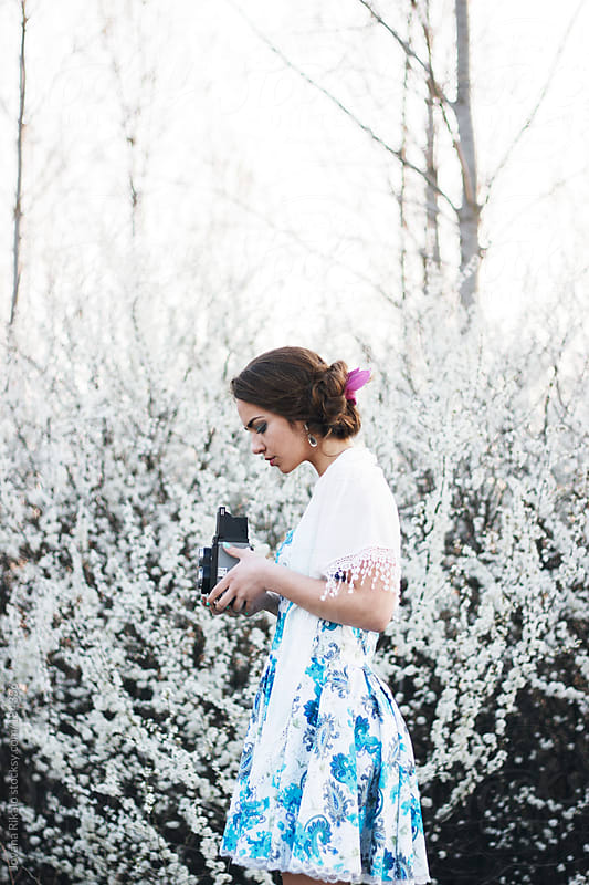 Young woman photographing with an old camera by Jovana Rikalo for Stocksy United