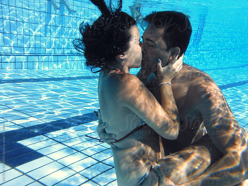 Couple Kissing Under Water by VICTOR TORRES for Stocksy United