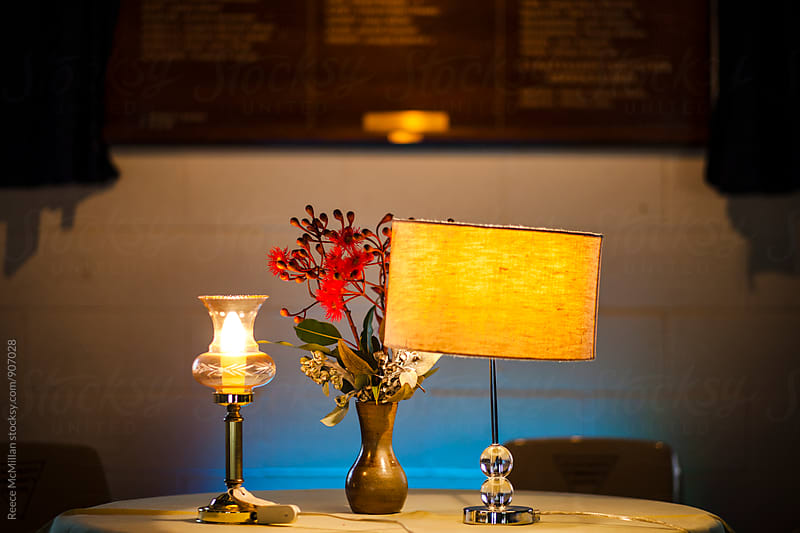 Vintage Lamps and Flowers on a table by Reece McMillan for Stocksy United