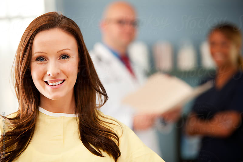 Exam Room: Cheerful Patient in Exam Room by Sean Locke for Stocksy United