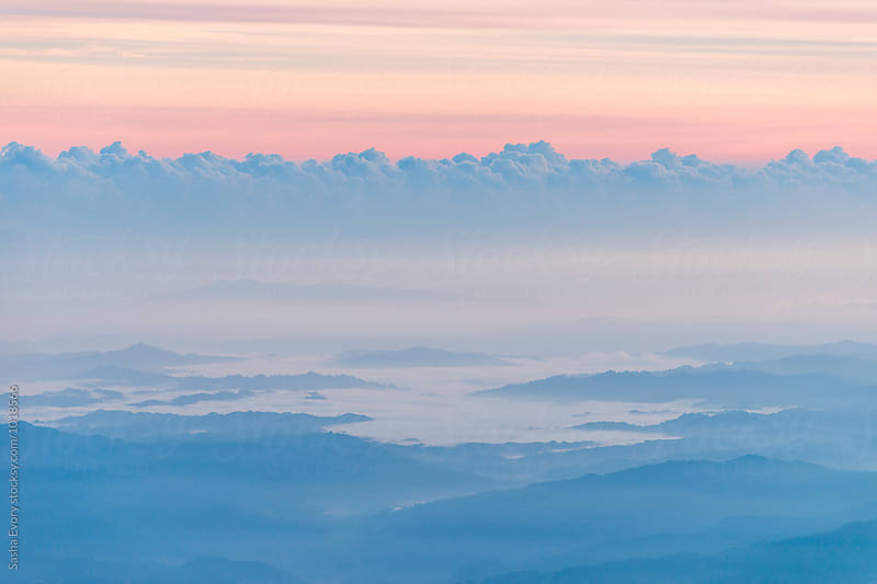 A view from summit above the clouds by Sasha Evory for Stocksy United